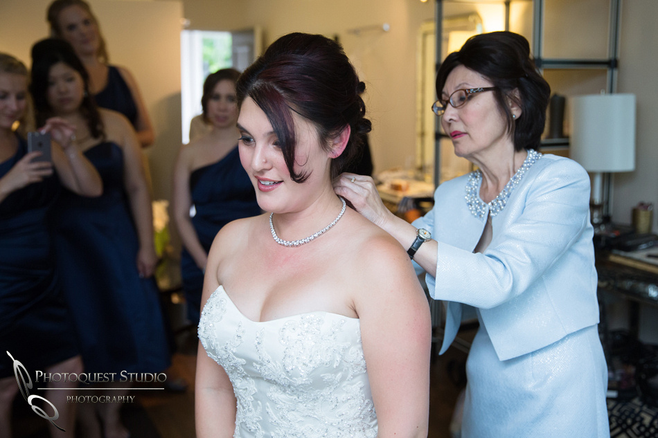 Mom helping the bride at Pala Mesa Resort Fallbrook by Temecula Wedding Photographer