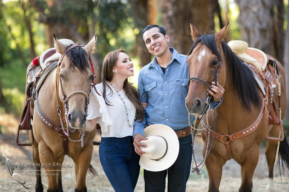 Cute moment Fairmount Park, California Engagement Photo with Horses by Temecula Wedding Photographer