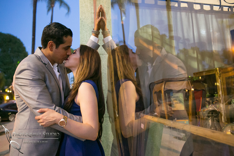 Mirror kissing at Mission Inn California Engagement Photo by Temecula Wedding Photographer