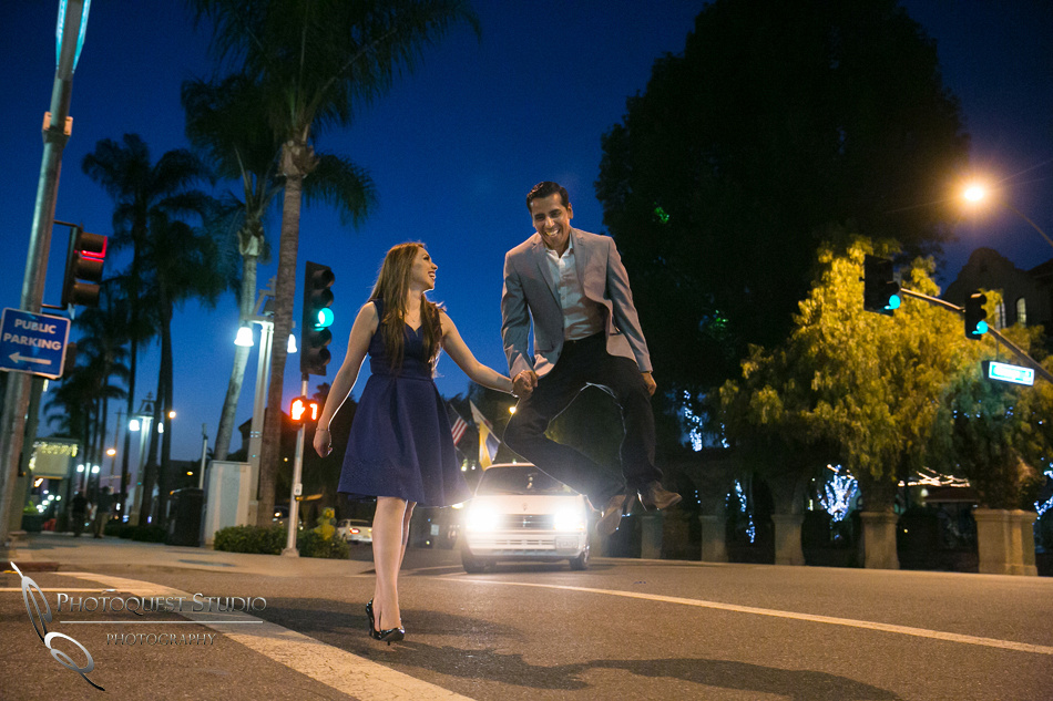 Happy heal kick at Riverside Downtown, California Engagement Photo by Temecula Wedding Photographer