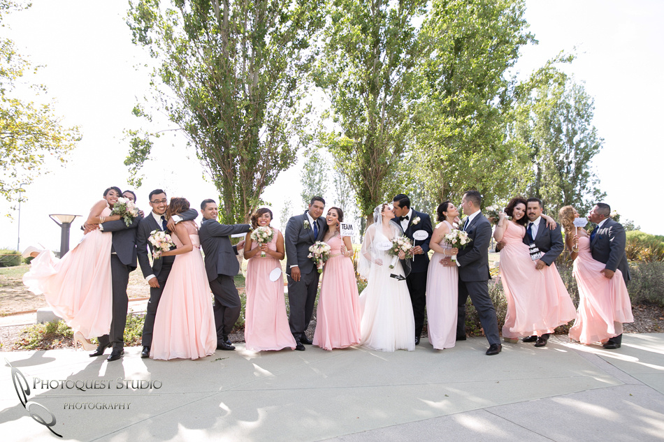 kissing and cheer by the bridal party