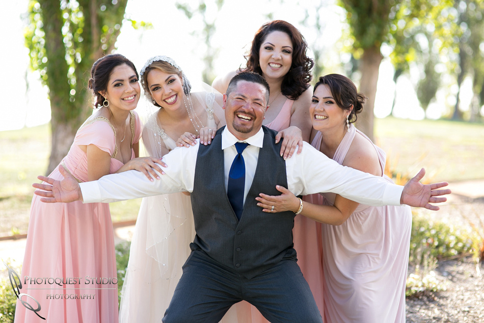 happy brother and sisters at wedding