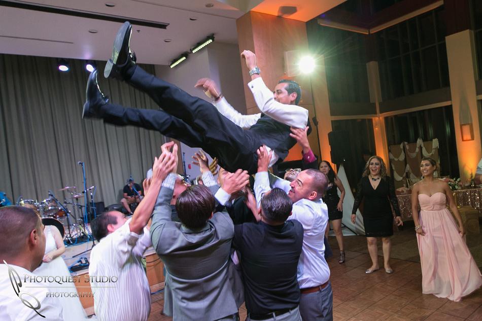 flying groom at diamond bar center by riverside wedding photographer