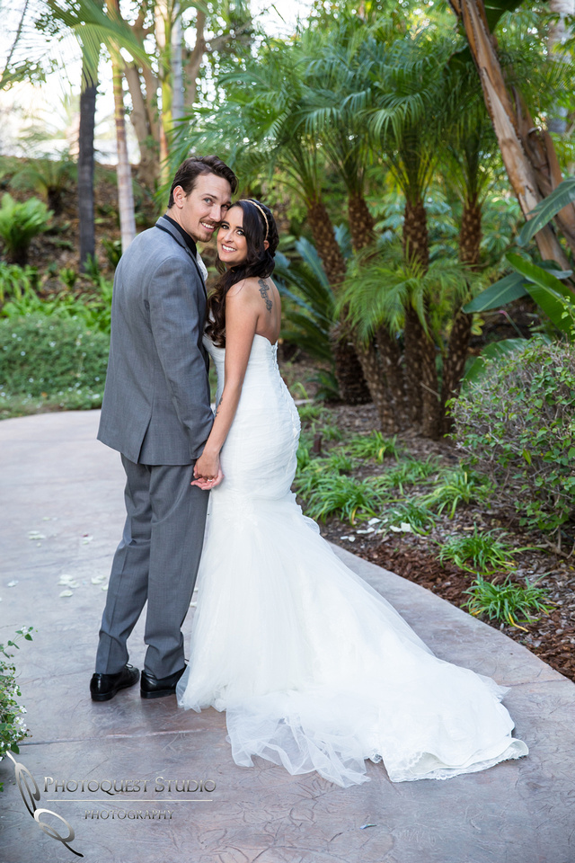 Bride and Groom hand in hand. Wedding photos at Grand Tradition Estate Fallbrook by Wedding Photographer in Temecula