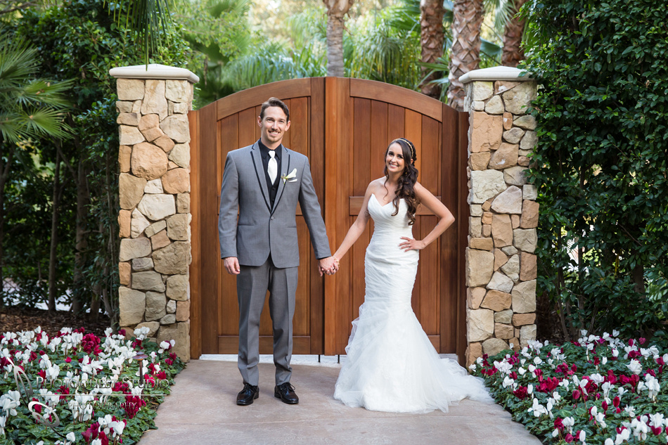 standing by the door. Wedding photos at Grand Tradition Estate Fallbrook by Wedding Photographer in Temecula