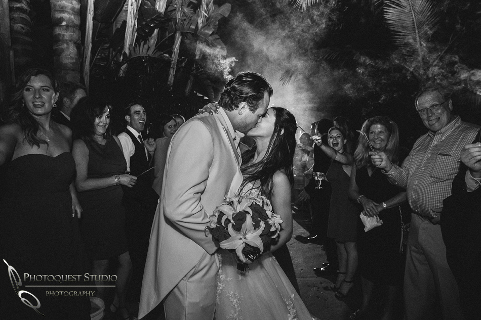 Kissing and sparkler exit at Grand Tradition Estate Fallbrook by Temecula Wedding Photographer