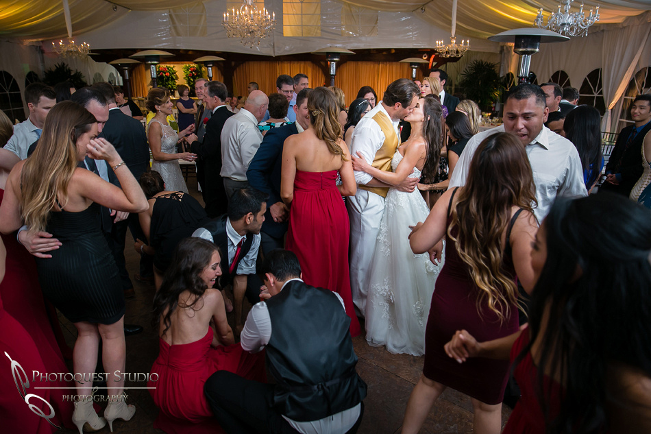 Bride and groom kissing like no body is looking by Temecula Wedding Photographer