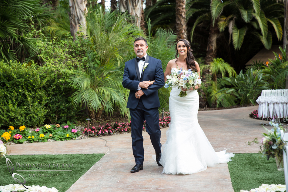 Father and the bride walking down. Wedding photos at Grand Tradition Estate Fallbrook by Wedding Photographer in Temecula