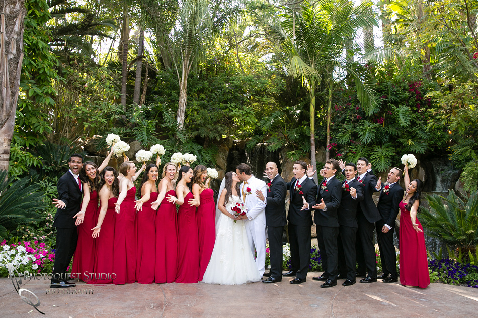 Kiss and cheer at Grand Tradition Estate Fallbrook by Temecula Wedding Photographer