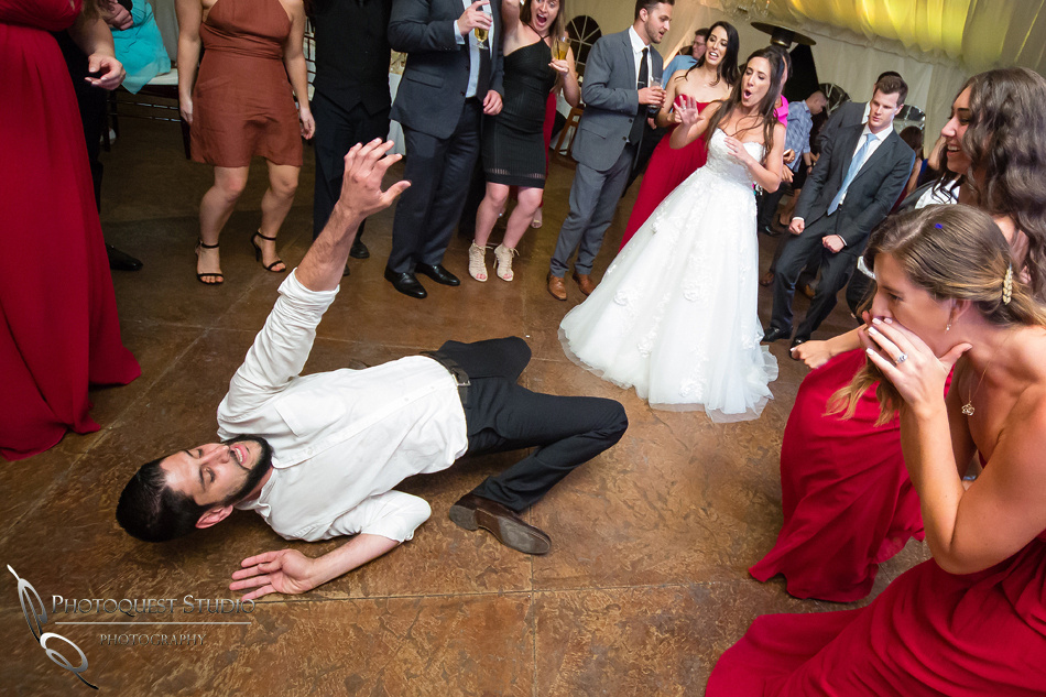 Bent over backward dance move at Grand Tradition Estate Fallbrook by Temecula Wedding Photographer