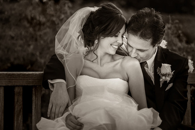 Kissing her on the shoulder at Ponte Winery Wedding by Temecula wedding photographer