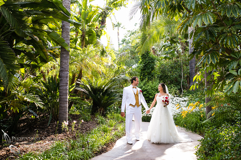 Bride and Groom walking hand in hand at Grand Tradition Estate by Fallbrook Wedding Photographer
