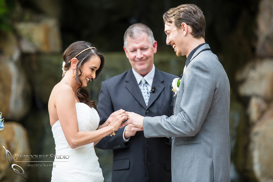 Ring exchange. Wedding photos at Grand Tradition Estate Fallbrook by Wedding Photographer in Temecula