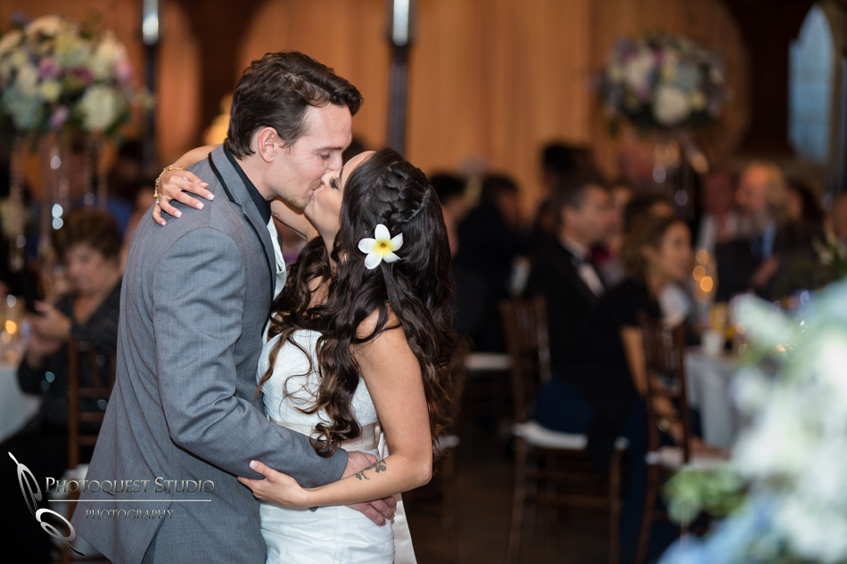 Kissing at the first dance. Wedding photos at Grand Tradition Estate Fallbrook by Wedding Photographer in Temecula