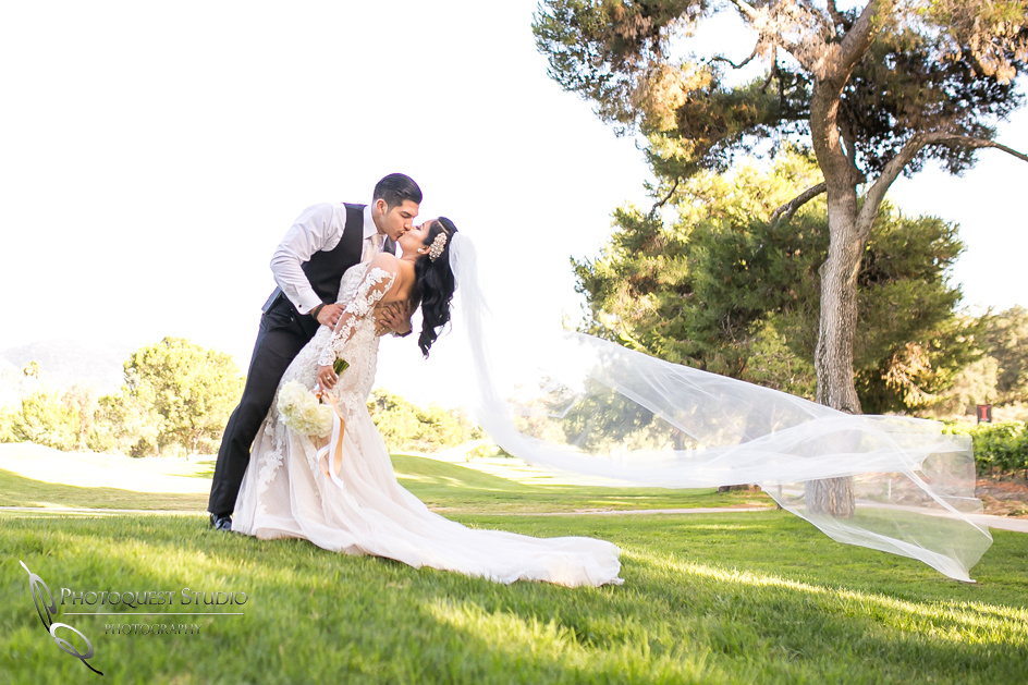 Dip and kiss by Temecula Wedding Photographer at Pala Mesa Resort, Fallbrook, San Diego, California.
