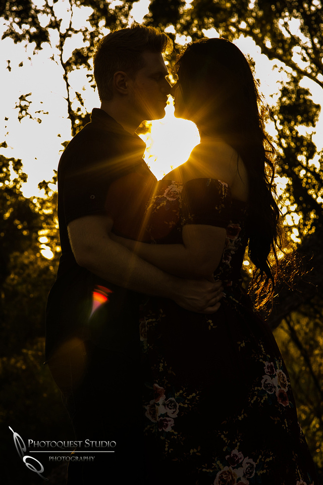 Kissing at sunset at Engagement Photo at Hillcrest Park, Fullerton