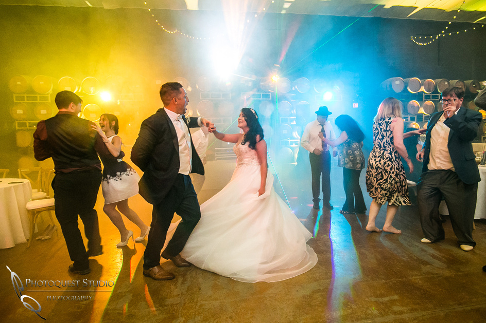 bride and groom dancing at Leoness Cellars wedding by Temecula Winery Photographer
