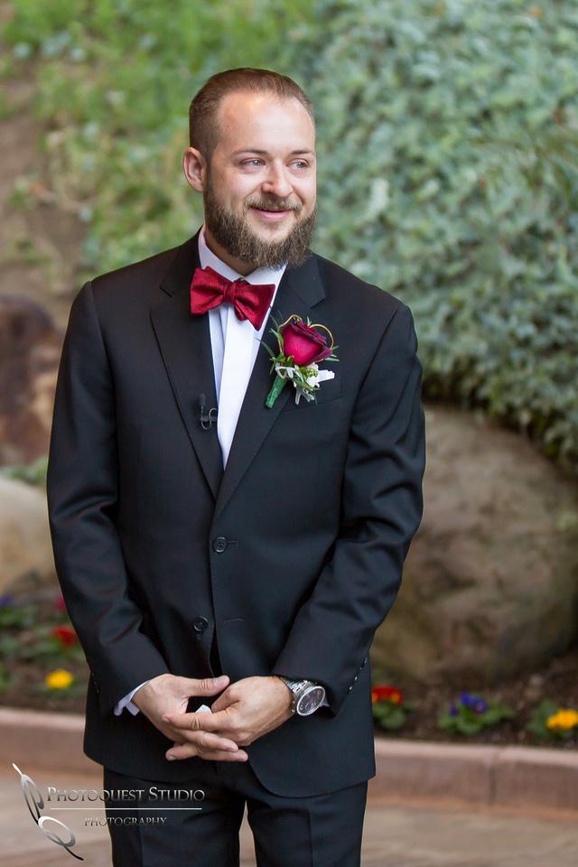 Groom watching his bride enter wedding ceremony