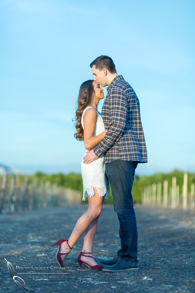 Lovely forehead kiss at Wiens, Temecula Winery Wedding Photographer
