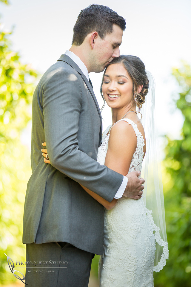 Kissing her forehead, Temecula-Wedding-Photographer