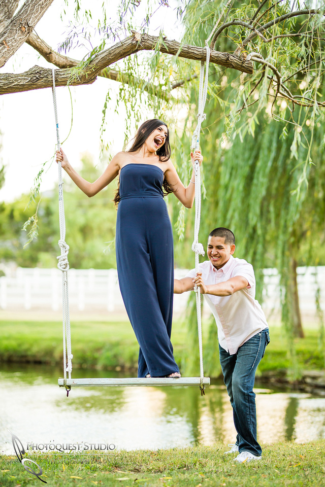 Fun time on the swing engagement photo by Wedding Photographer