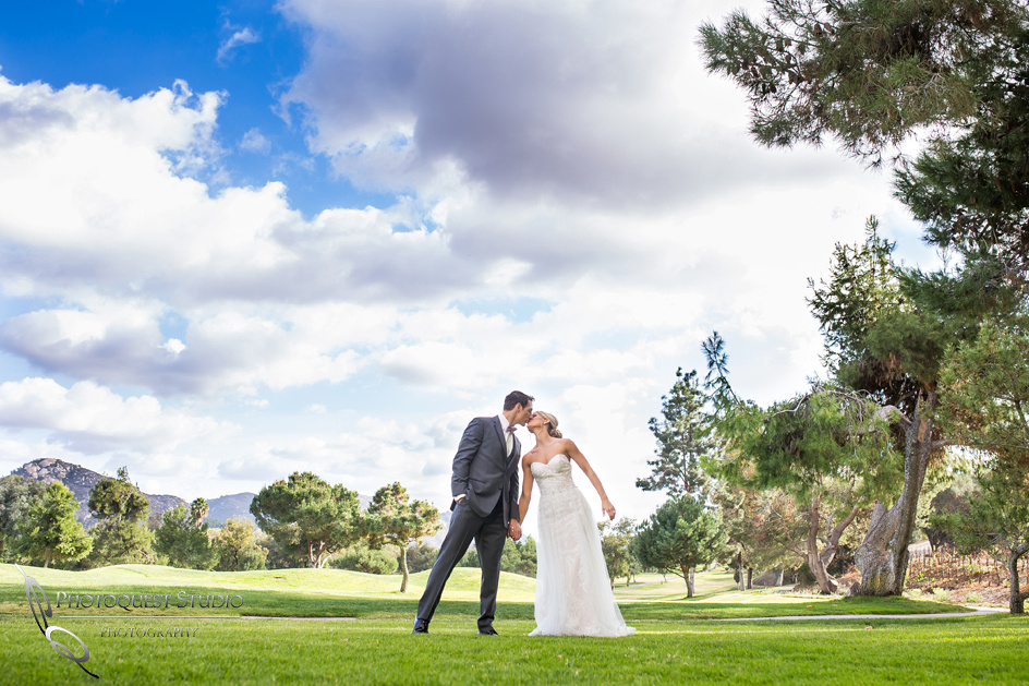 Lovely kiss at Fallbrook, San Diego wedding by temecula photographer