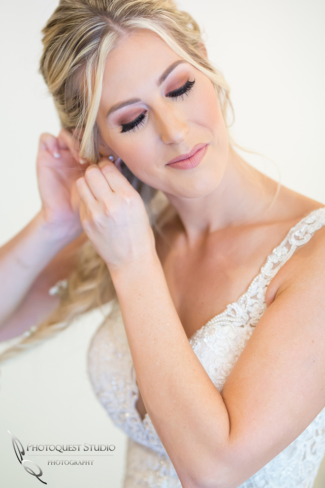 Gorgeous Bride putting on her earring, photo by Temecula Wedding Photographer