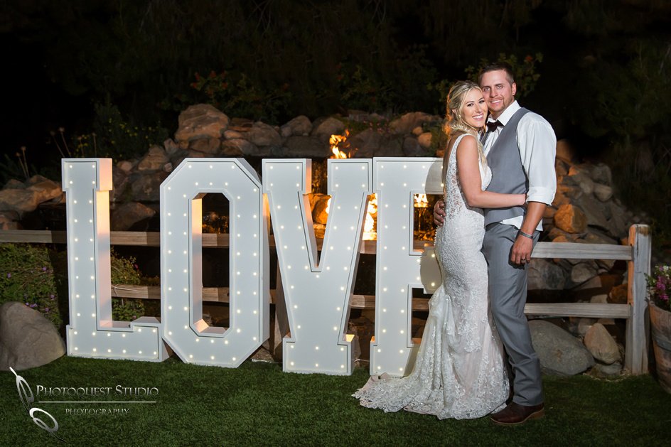Bride and Groom by LED LOVE sign