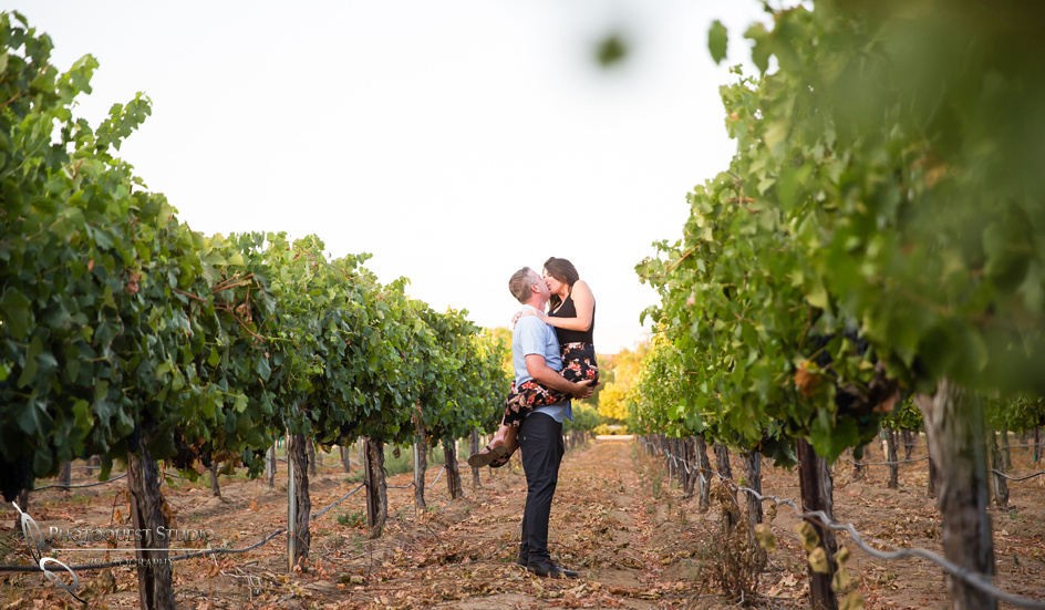 Kissing at South-Coast-Winery, Surprise-Proposal-Photo-in-Temecula