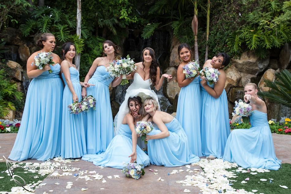 bride and bridesmaid having fun. Wedding photos at Grand Tradition Estate Fallbrook by Wedding Photographer in Temecula