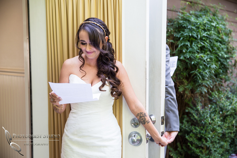 Pretty Bride holding hand and reading love letter. Wedding photos at Grand Tradition Estate Fallbrook by Wedding Photographer in Temecula