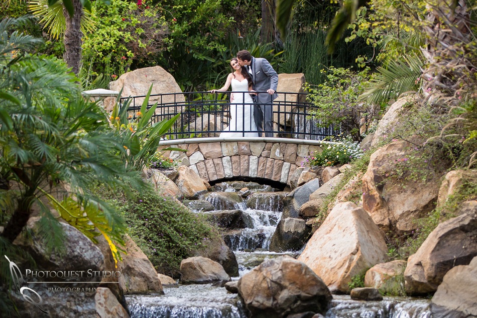 Kissing her by the waterfall. Wedding photos at Grand Tradition Estate Fallbrook by Wedding Photographer in Temecula
