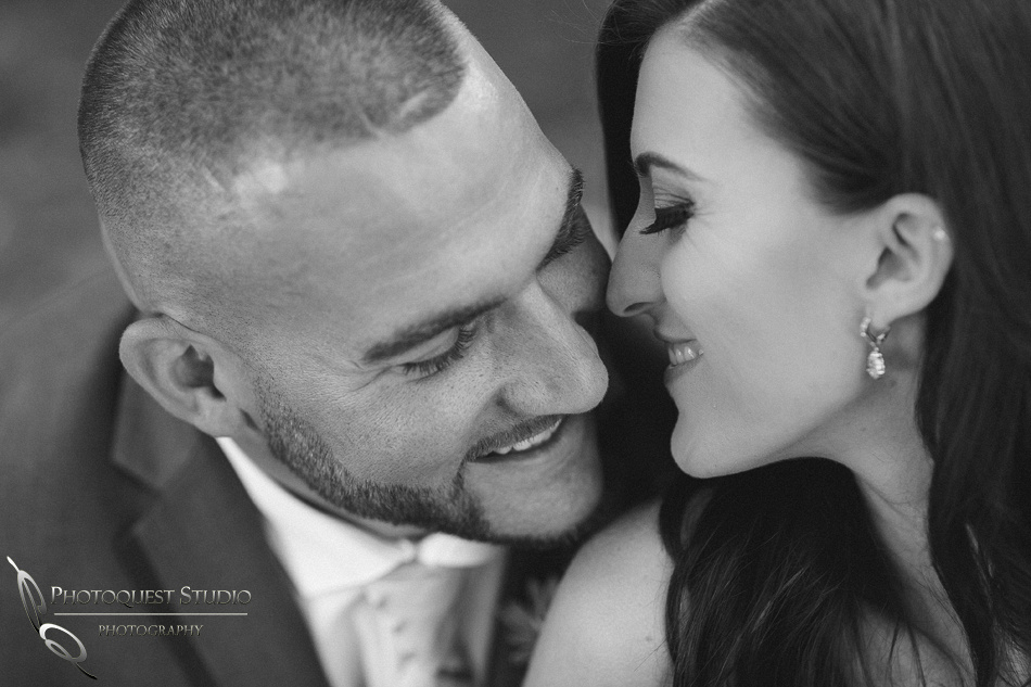 Cute couple at Lake Oak Meadows, Temecula Winery by wedding Photographer of Photoquest Studio