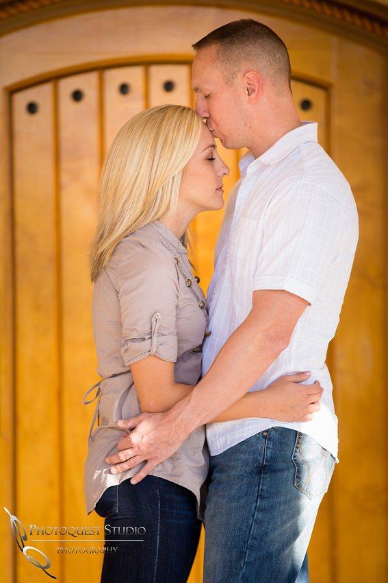 A quite moment with a kiss at Engagement photo at South Coast Winery, California by Temecula Wedding Photographers