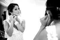 Bride putting on her earing by Temecula Wedding Photographer