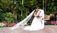Kissing with flying veil at Grand Tradition Estate Fallbrook by Temecula Wedding Photographer