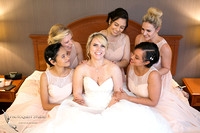 Bride and Bridesmaids having fun on the bed by Temecula, Fallbrook wedding photographer