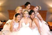Bride and Bridesmaids being funny on the bed by Temecula, Fallbrook wedding photographer