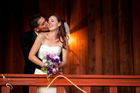 the groom lovely kiss at Falkner winery wine wedding by temecula wedding photographer