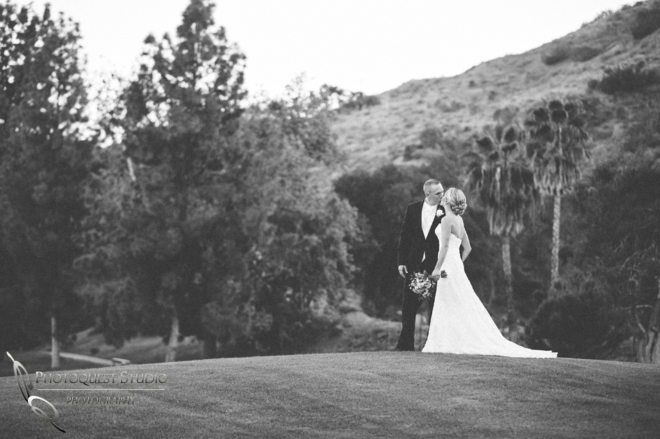 Bride and Groom kissing on the Golf course, Pala Mesa Resort Wedding Temecula Wedding Photographers