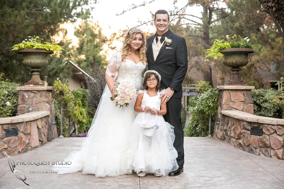 Bride and Groom with their daughter by Fallbrook, Temecula Wedding Photographer