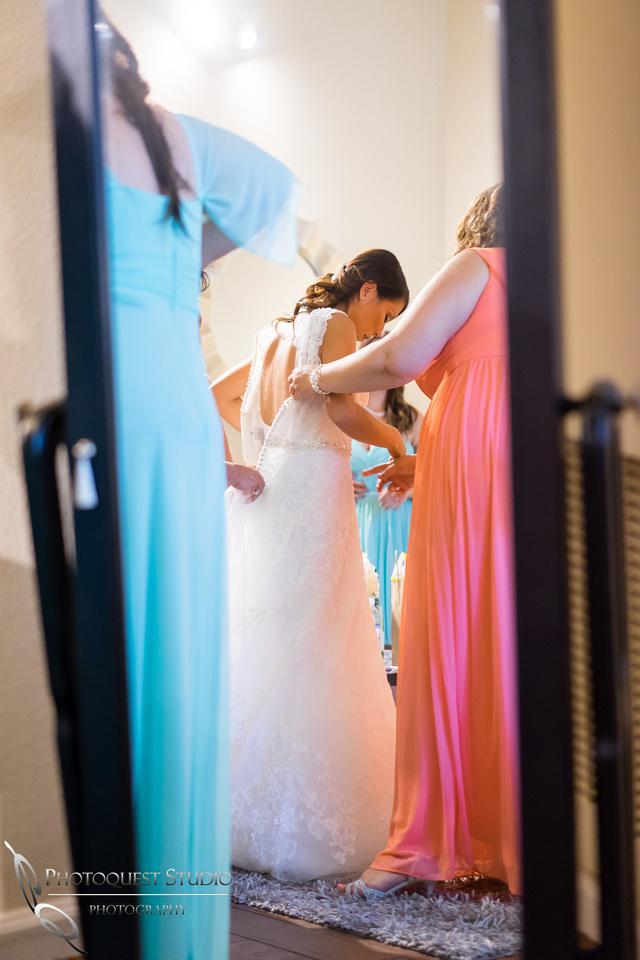 Monica putting on wedding dress