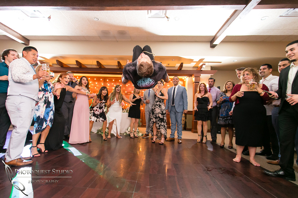 Flipping Wedding Photo at Wiens Family Cellars  by Temecula Wedding Photographer