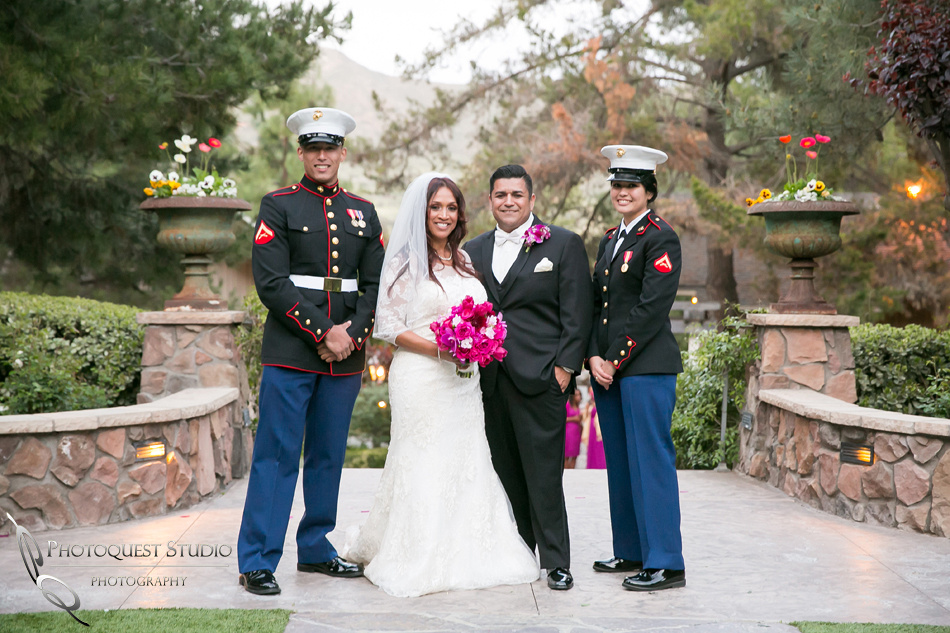 the bride and groom and the military couple