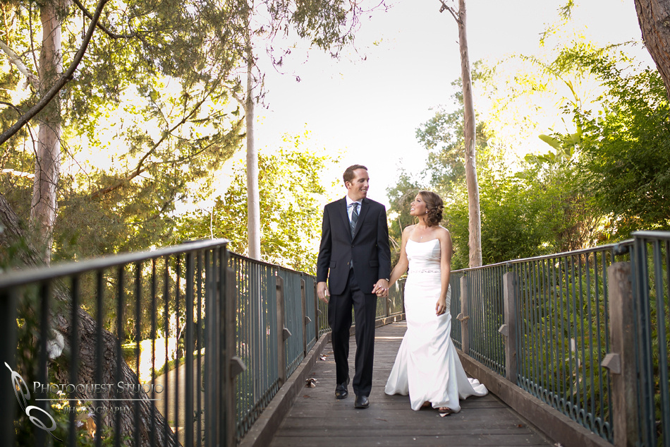 Hand in hand over the bridge-by-Wedding-Photographer-in-Temecula,-Ashley-&-Kyle