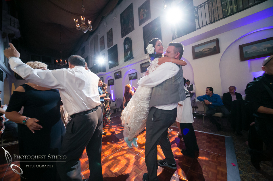 Bride and Groom happy spin by Temecula Wedding Photographer of Photoquest Studio Photography
