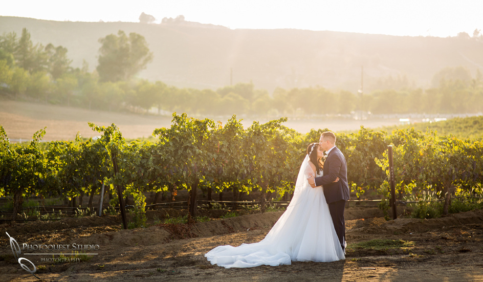 Kissing by Temecula wedding photographer