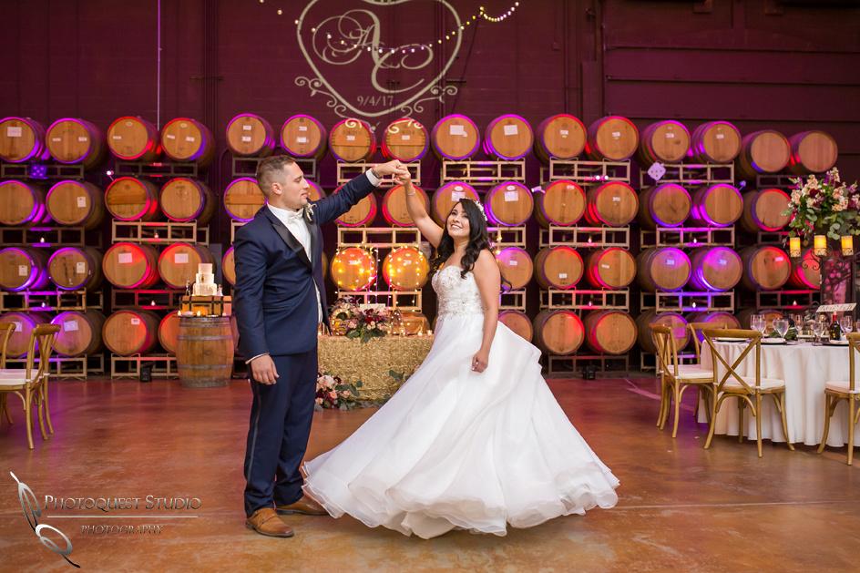 Bride and groom dancing in barrel room