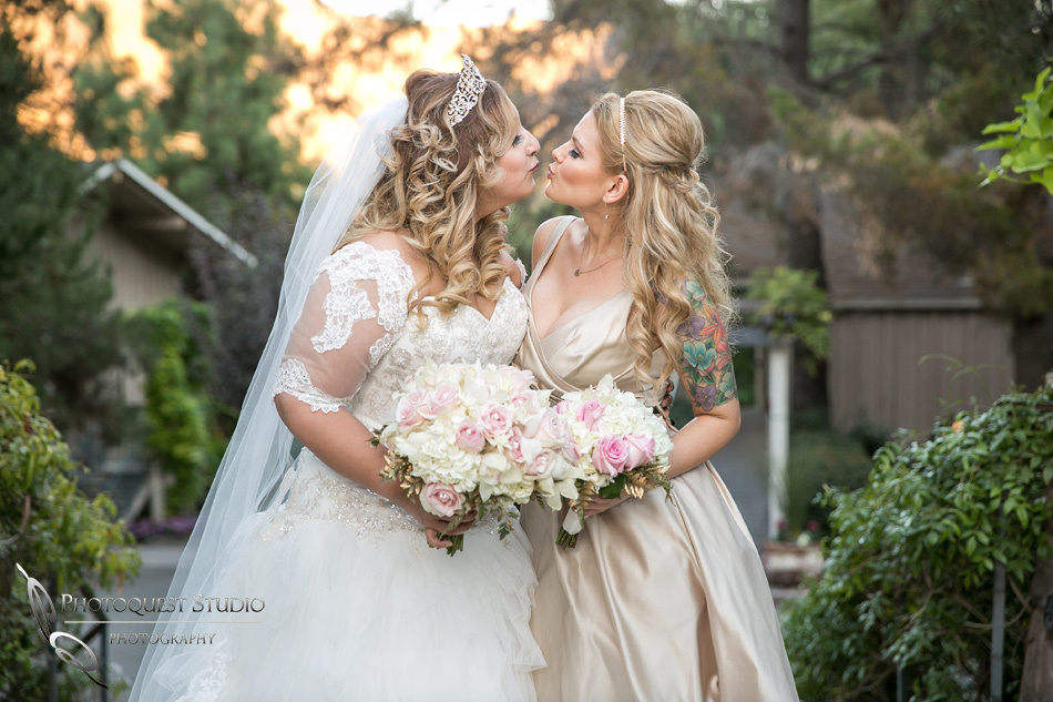 Bride and Bridesmaid kissing by Fallbrook, Temecula Wedding Photographer