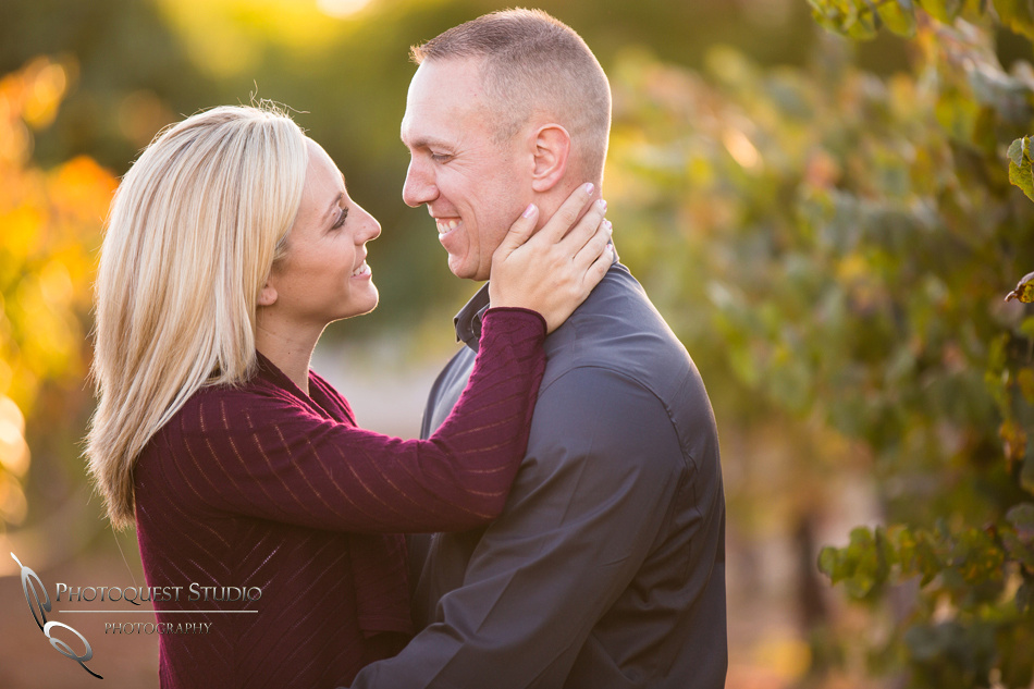 cheerful moment at the vineyard at Engagement photo at South Coast Winery, California by Temecula Wedding Photographers